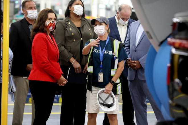 Michigan Governor Gretchen Whitmer looks on as Penny Cauzillo talks to her about the payload tester she operates on the 2022 Ford F-150 Lightning inside the plant where it will be built, the Rouge Electric Vehicle Center at the Ford Rouge Plant in Dearborn, Michigan.