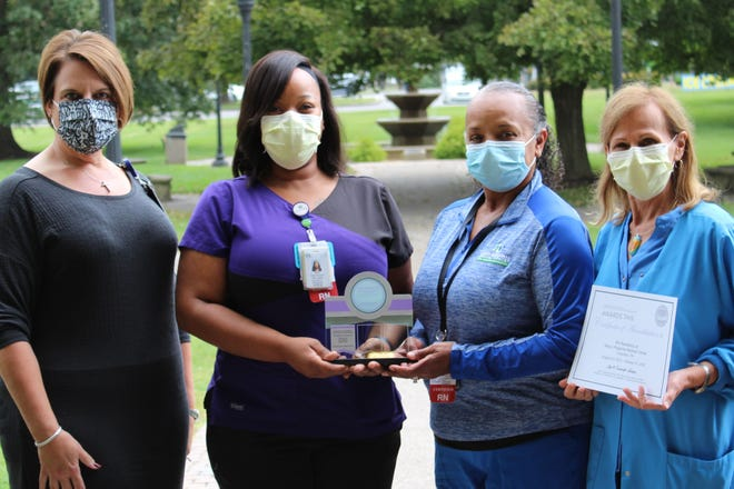 Chief Nursing Officer Deborah Lumpkins, DNP, RN, NEA-BC, (far left) stands alongside Nurse Residency Site Coordinators Tracy Ferguson, MSN, RN, CMS-RN, and Jackie Miles, MSN, MA, RN, CCRN, as well as Nurse Residency Director Sue MacArthur, EdD, MSN, FNP, NPD-BC.