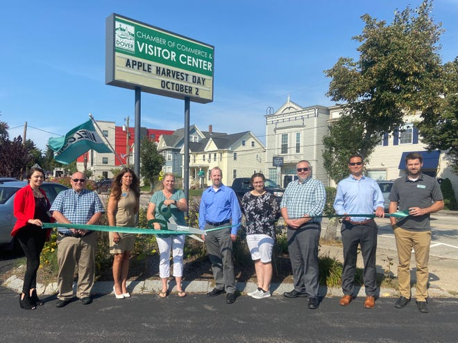 Payment Solutions is welcomed to the Greater Dover Chamber of Commerce by Dover Mayor Robert Carrier and chamber representatives.