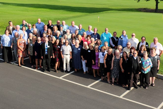 The Dover High School Class of 1071 held its 50th reunion on Sept. 24 to 26, 2021. Attendees pose for a class photo at the Cochecho Country Club in Dover..