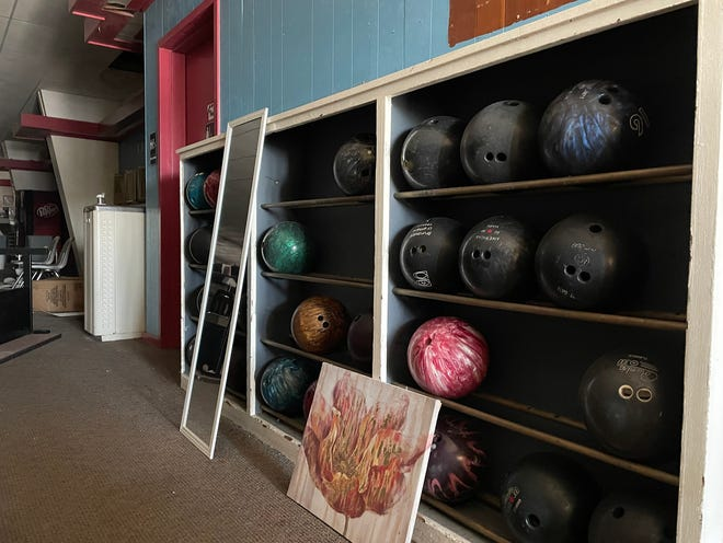 Contents inside Northgate Lanes, 1576 N. Henderson St., are being removed in preparation for the sale of the longtime bowling alley.