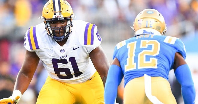 East Ascension alum Cam Wire has not played since he injured his knee in LSU's season opener against UCLA.