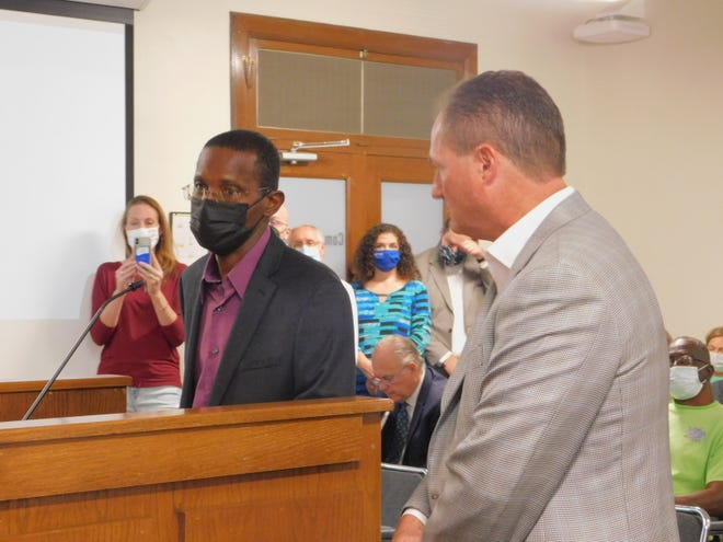 Al Hambrick and Sherman Mayor David Plyler speak before Grayson County Commissioners on the creation of a new committee to discuss possible recognition of the 1930 Sherman Riot, the lynching of George Hughes and destruction of Grayson County Courthouse and Sherman's black business district.