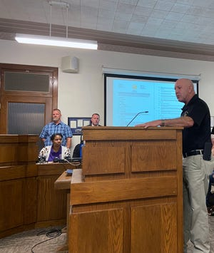 Grayson County Sheriff Tom Watt talks about Investigator Dusty Wainscott at commissioners court Tuesday. Wainscott died while on duty earlier this month and commissioners Tuesday approved giving his gun and badge to his wife.