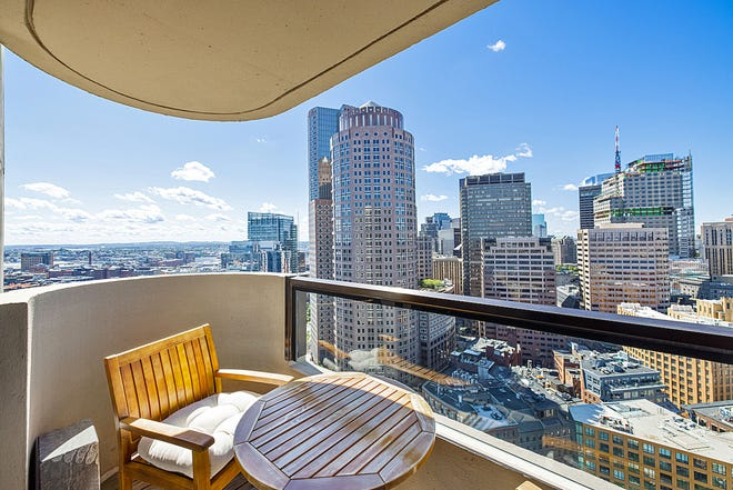 Relax and enjoy all the great views of the city from this balcony.