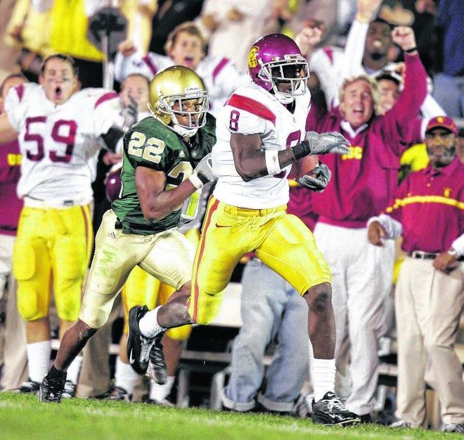 Dwayne Jarrett sneaked behind Notre Dame cornerback Ambrose Wooden in the 2005 classic.