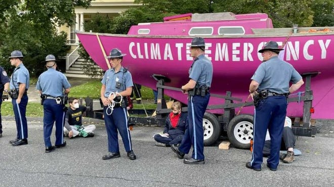 State troopers surround climate protesters in Swampscott on Tuesday, Sept. 28, 2021.