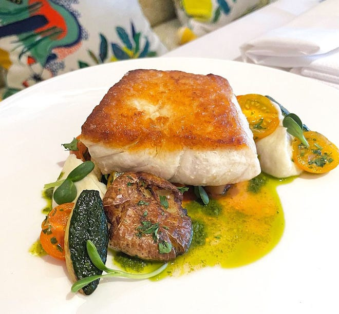 A periodic daily special at Swifty's at The Colony features seared tripletail with smoked sunchoke puree, tomato-and-squash ragu, and caper-and-herb vinaigrette.