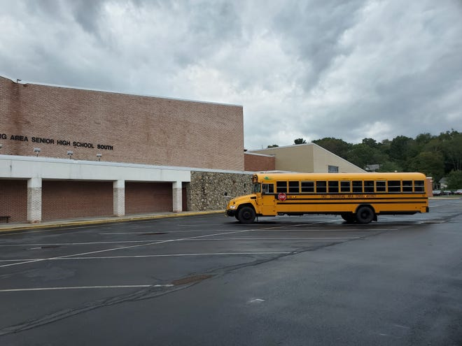 An East Stroudsburg Area School District bus sits parked outside the East Stroudsburg Area Senior High School South building on Sept. 28, 2021.