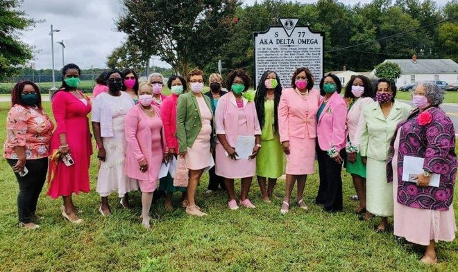 Members of Alpha Kappa Alpha Delta Omega Chapter members pose for a photo in front of the historical highway marker after their unveiling ceremony at the Ettrick-Matoaca Library in Chesterfield, Va. on Sept. 17, 2021.