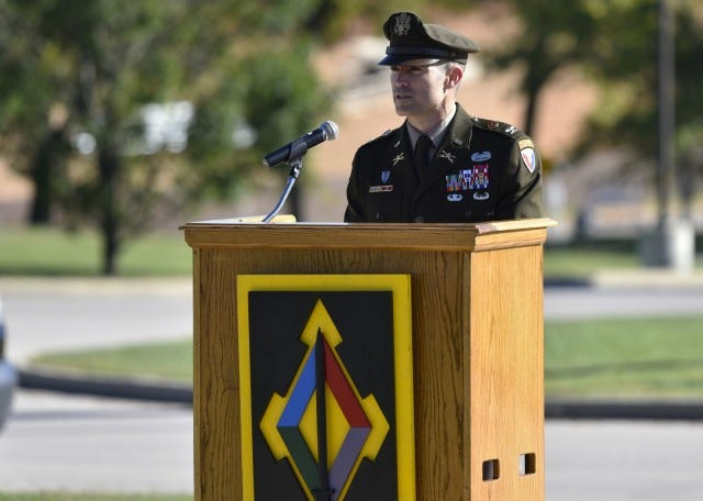 """Col. Jeff Paine, U.S. Army Garrison Fort Leonard Wood commander, speaks at the Gold Star Families recognition event Sept. 25 on the Maneuver Support Center of Excellence Plaza. Paine called it """"moving and humbling"""" to see the displays set up by the Gold Star families and hear the stories of the loved ones they lost. (Photo by Brian Hill, Fort Leonard Wood Public Affairs Office)"""