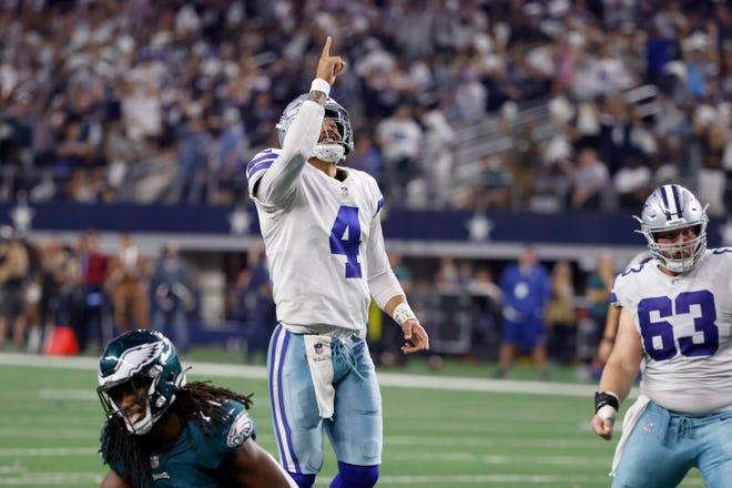 Dallas Cowboys quarterback Dak Prescott (4) and center Tyler Biadasz (63) celebrate a touchdown scored by Dalton Schultz in the second half of an NFL football game against the Philadelphia Eagles in Arlington   on Monday.
