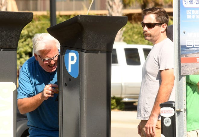 The Carolina Beach town council ended its contract with Reef Parking during a town council workshop meeting on Tuesday.
