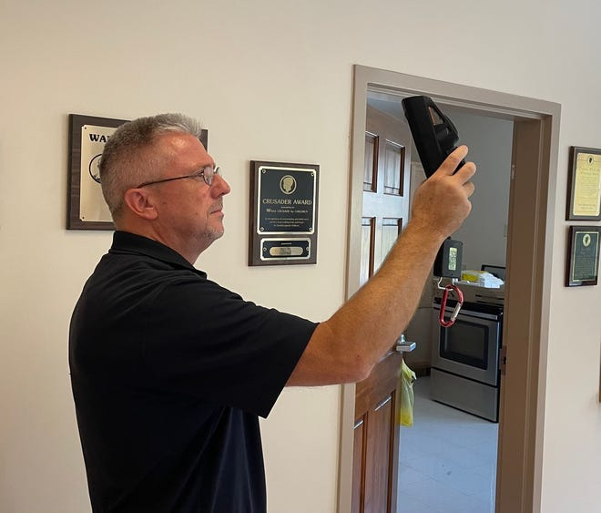 Paoli Fire Chief Mark Jones gives a demonstration with the Paoli Fire Department's new thermal imaging camera.