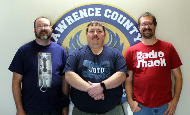 Justin Elliott, Nathan Lowery and Tim Wray pose for a photo inside Lawrence County Independent Schools.