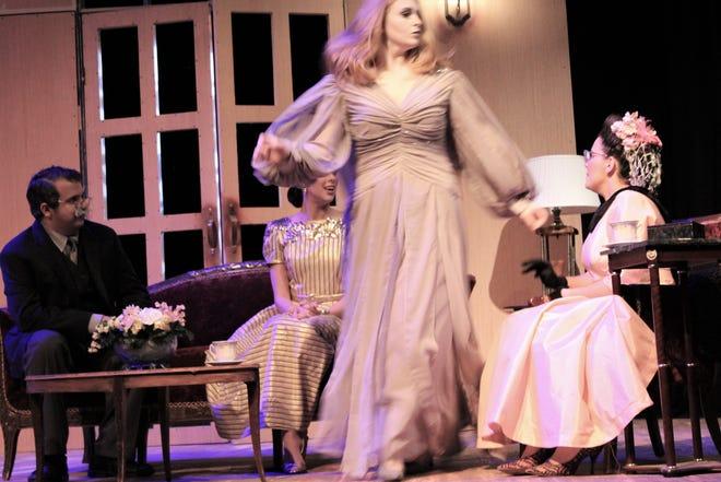 "The spirt of Elvira Condomine (Bailey Barrett) whisks through the parlor where she is not seen by Dr. Bradman (Tony Barone, left), Ruth Condomine (Peyton Scroggins) and Mrs. Bradman (Roni McAlister) in this rehearsal scene from ""Blithe Spirit"" by Hardin-Simmons University."
