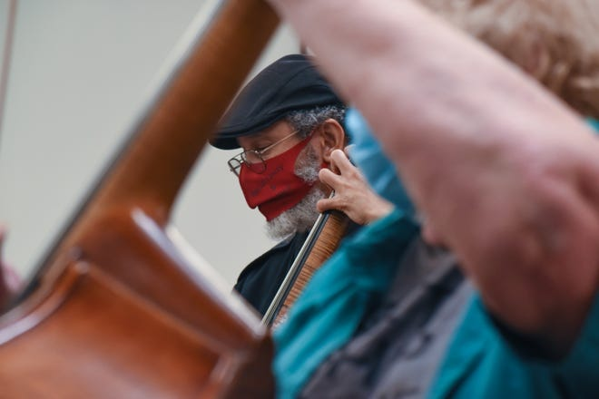 Musicians with the Bremerton WestSound Symphony rehearse socially distanced at the Manette Community Church on Monday. The symphony is preparing for a season of in-person concerts after performing virtually during the pandemic in 2020 and 2021.