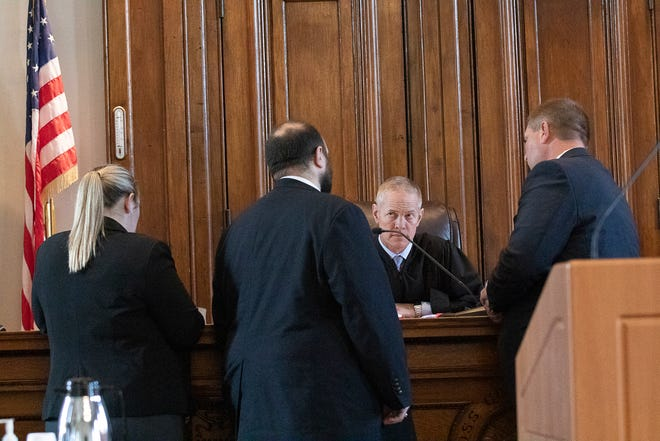 Judge Matthew Schmidt confers with council before opening arguments in the case against Chad Kuntz on Sept. 28, 2021.