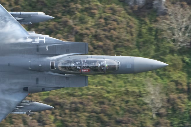 The Governors flag facing through the cockpit window as the jet navigates the world-famous Mach Loop (aka the Machynlleth Loop), based out of Royal Air Force Lakenheath, in the United Kingdom.