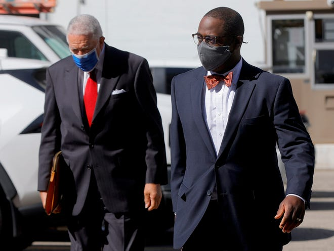 With his lawyer behind him, Detroit Councilman Andre Spivey heads into federal court in Detroit for plea hearing in front of U.S. District Judge Victoria Roberts on Tuesday, September 28, 2021.