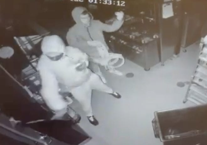 Surveillance video of individuals breaking in at Tactical Advantage Guns in Portage and stealing numerous laser-equipped training pistols, with a total value of more than $1,000. Dylan Hinkle and Emanuel Northern are accused in a break-in. They are being held on $50,000 bond in the Kent County Jail on a federal charge of conducting a criminal enterprise as they await possible other charges. Detectives believe the suspects had identified buyers for the stolen weapons.