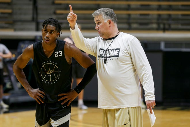 Purdue head coach Matt Painter talks with Purdue guard Jaden Ivey (23) during practice, Tuesday, Sept. 28, 2021 at Mackey Arena in West Lafayette.