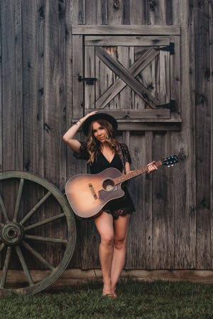 """Country singer-songwriter Allie Sealey, who graduated from Middle Tennessee State University, will perform her award-winning song, """"Not All in Our Heads,"""" at the National Headache Foundation's annual gala Oct. 2 in Chicago."""