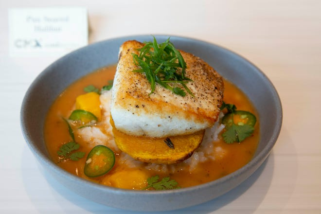 Pan-seared halibut from the new CMX CinéBistro at Coastland Center, Naples.