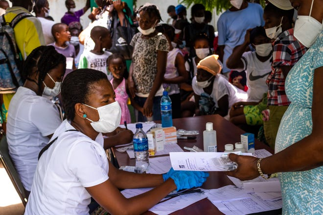 Hope for Haiti staff at intake for one of the four mobile clinics it has been operating since the earthquake Aug. 14.