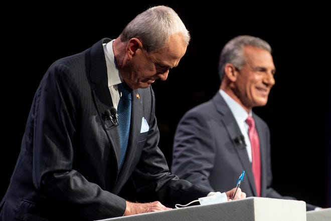 The first New Jersey gubernatorial debate between incumbent Gov. Phil Murphy (D-NJ), from left, and Republican challenger Jack Ciattarelli is being held at New Jersey Performing Arts Center in Newark, NJ on September 28, 2021.