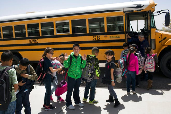 In this March 31, 2017, file photo, students board a school bus after class at Columbus Elementary School in Columbus, N.M. New Mexico Public Education Department officials say, Monday, Sept. 28, 2021, few grade-school students participated in state testing last year and that it is impossible to measure learning loss from the pandemic.