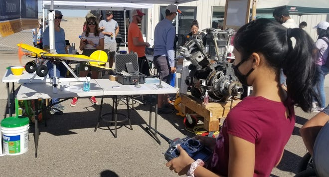Girls learn about science, technology, engineering and math (STEM) at the Girls in Aviation Day event in Albuquerque