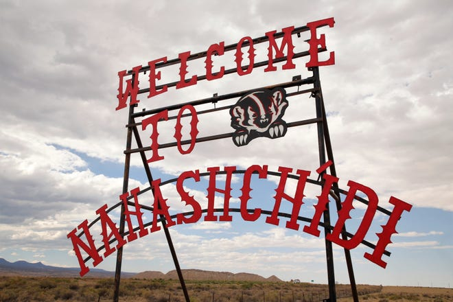The welcome sign for Naschitti spells the community's name in the Navajo language. Naschitti is among the communities placed under a health advisory notice on Sept. 27 by the Navajo Department of Health for COVID-19 infections.