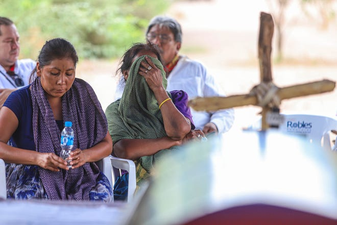 Mourners attend the burial service for Indigenous rights leader Tomas Rojo in the Yaqui Indigenous community Vicam, Sonora state, Mexico, Saturday, July 10, 2021.