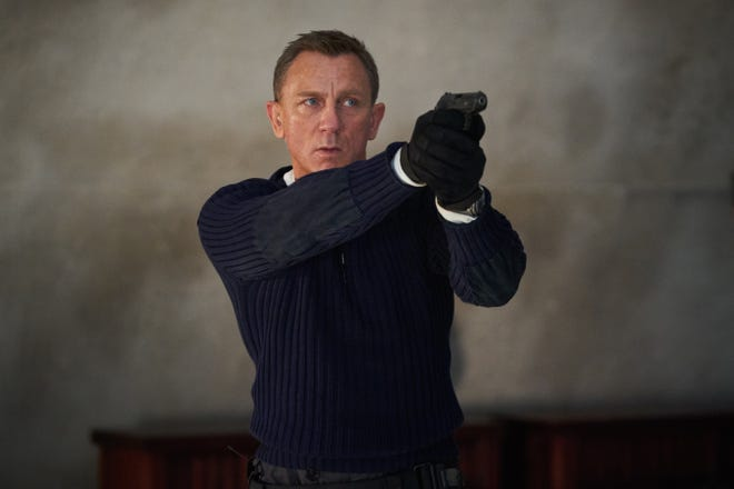 "James Bond (Daniel Craig) prepares to shoot in ""No Time to Die."""