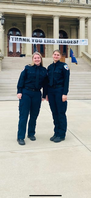 Tri-Hospital EMS paramedic Kathryn Fanson and EMT Chloe Messinger at the Michigan Association of Ambulance Services award ceremony at the state capitol on Tuesday, Sept. 21, 2021.