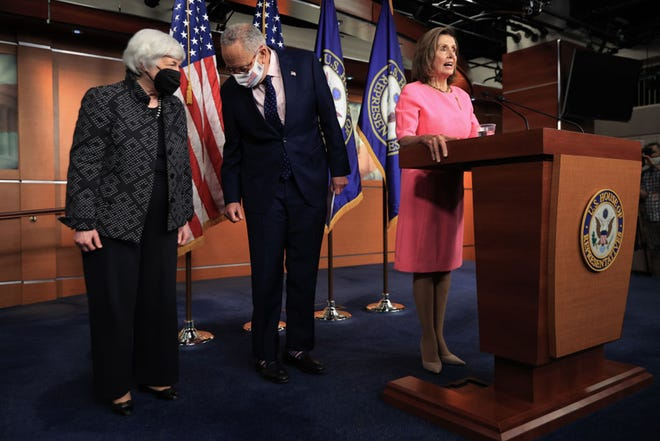 From left to right: Treasury Secretary Janet Yellen briefly joins Senate Majority Leader Charles Schumer, D-N.Y., and Speaker of the House Nancy Pelosi, D-Calif., during a news conference at the U.S. Capitol on Sept. 23, 2021, in Washington, D.C. Pelosi, Senate Majority Leader Charles Schumer and moderate and progressive congressional Democrats met with President Joe Biden at the White House Wednesday in an attempt to hammer out a deal on infrastructure and budget legislation. (Chip Somodevilla/Getty Images/TNS)