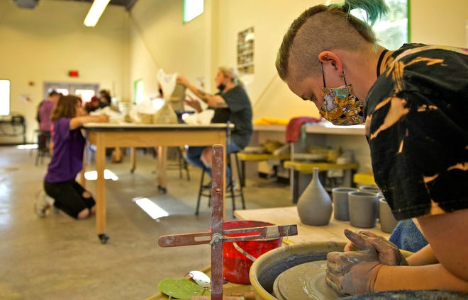 Kassie Dillworth, far right, works on a project in the Concho Clay Studio at the San Angelo Museum of Fine Arts on Saturday, Sept. 25, 2021.