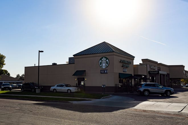 Cars line up in the drive-thru on Tuesday, September 28, 2021, at the Starbucks near 41st Street and Louise Avenue in Sioux Falls.