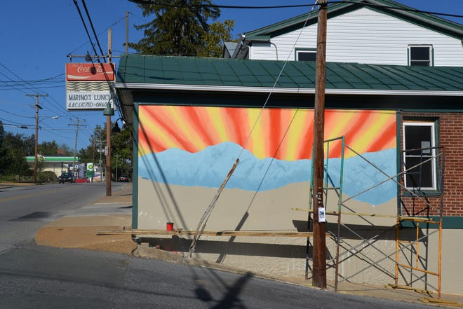 A new mural being painted on the side of Marino's in Staunton on Sept. 27, 2021.
