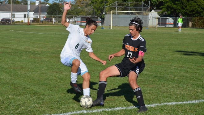 Dario DiLeonardo of Schalick (6) pulls the ball back, away from Middle Township's Steven Berrodin during first-half play in Monday's nonleague game.