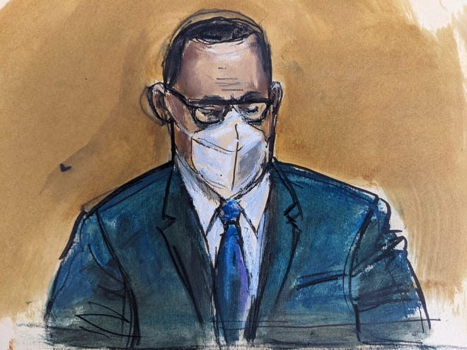 In a courtroom sketch, R. Kelly listens to the jury verdict at his sex-trafficking trial, Sept. 27, 2021, in federal court in New York.