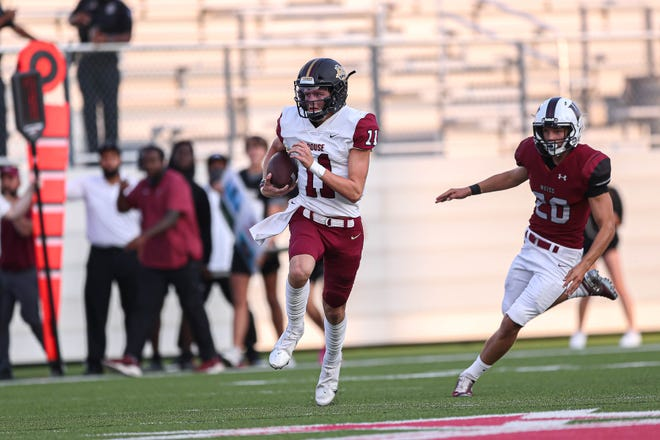 Rouse quarterback Mason Shorb runs the ball against Weiss earlier this season. Rouse rejoined the American-Statesman's Class 5A poll after a shutout win over Bastrop last week.