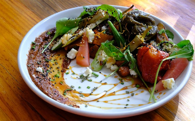 Chef Sonya Cote and her husband, David Barrow, moved their Eden East Farm to Bastrop, and she sources vegetables from it for dishes like this plate of barbecued veggies on romseco sauce at Store House Market & Eatery.