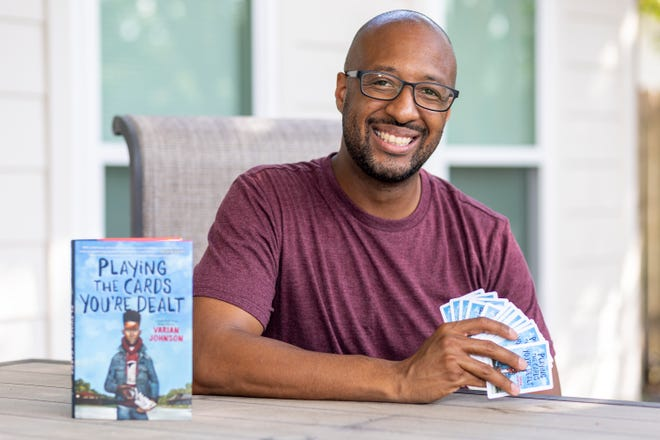 """Author Varian Johnson at his home in Round Rock on Sept. 28. Johnson played spades as a kid and the game figures into his new book, """"Playing the Cards You're Dealt."""""""