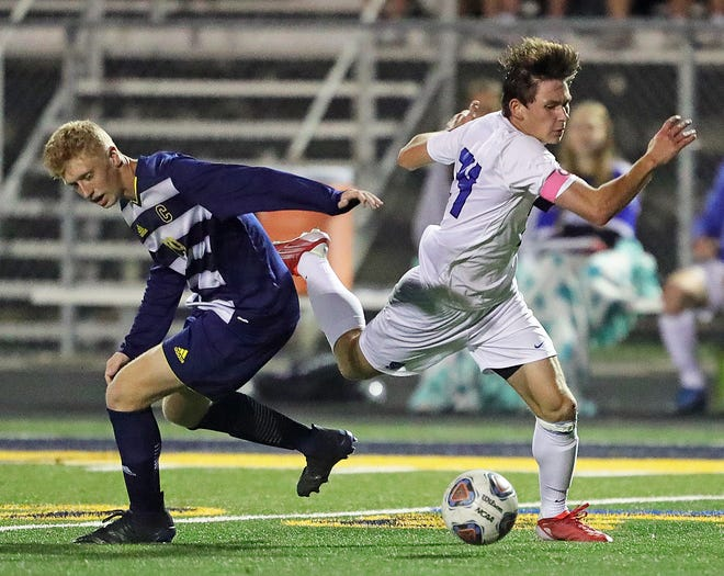 Revere's Trevor Rorabaugh, right, is tripped up by Copley's  Asher Hart during the second half of a soccer game, Tuesday, Sept. 28, 2021, in Copley, Ohio.