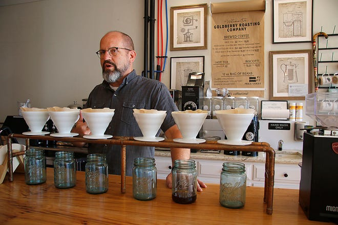Doug Cooper, owner of Goldberry Roasting Co., on Claremont Avenue in Ashland talks behind the pour-over station where cups of coffee are made one cup at a time with the beans freshly ground and hot water poured over the grounds to make a cup of coffee on Wednesday, Sept. 29, 2021.