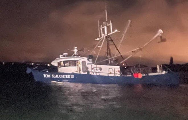 Four men were rescued from a fishing boat ran aground off Point Gammon on Great Island in West Yarmouth Tuesday night. Coast Guard Photo