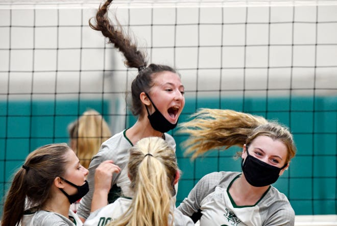 Dennis-Yarmouth players celebrate after winning the fourth set against Barnstable on Tuesday.