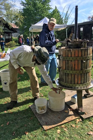 One of the joys of fall is fresh-pressed cider, from local apples. Enjoy a taste and get some sourdough bread while it lasts at the Folk Art Guild Oct. 9 and 10, noon to 5 p.m. both days. Here, Bill Glasner, of Victor, and Peter O'Biso, of Naples, take a turn at the press.
